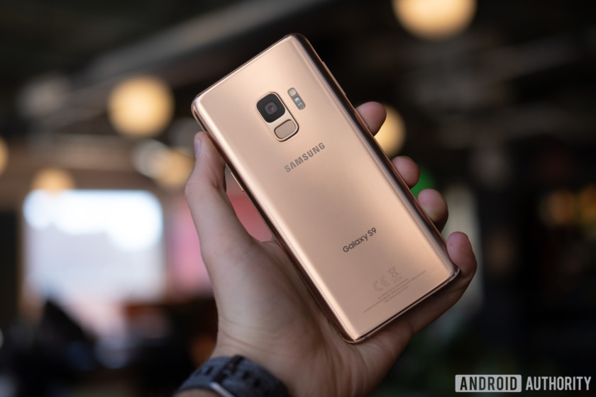 Samsung Galaxy S9 smartphone in sunrise gold in a person's hand.