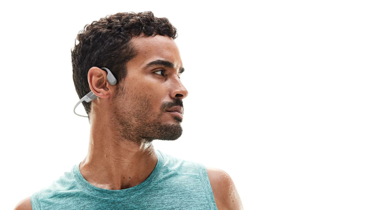 A picture of a man in profile wearing the AfterShokz Aeropex bone conduction headphones.