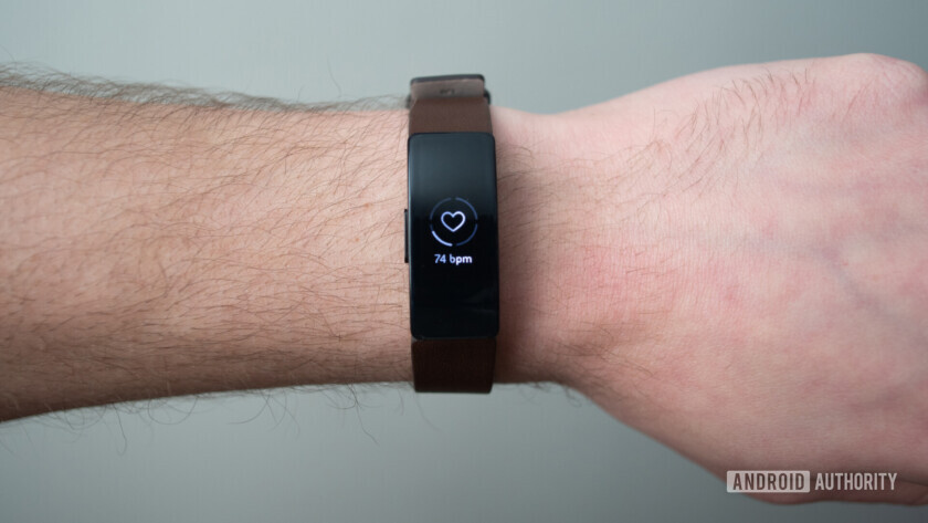 fitbit inspire hr display brown leather strap on wrist heart rate