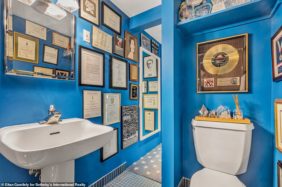 Unique:Susan styled one full bath in the loft with cobalt blue paint and calls it the Academy Award bath, according to WSJ ; the bathroom features her Oscar Award and SAG Award for Dead Man Walking, as well as her 1995 Glamour Woman of the Year Award