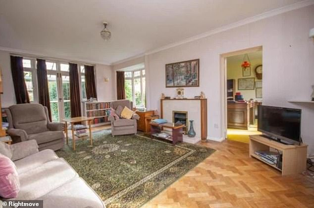 Potential: A large living space with French doors looking out into the garden also boasts a stunning Parquet flooring, however it remains to be seen which features will remain