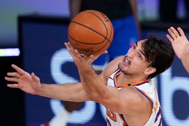 Phoenix Suns forward Dario Saric (20) reaches for the ball during the first half of an NBA basketball game against the Philadelphia 76ers Tuesday, Aug. 11, 2020, in Lake Buena Vista, Fla. (AP Photo/Ashley Landis, Pool).