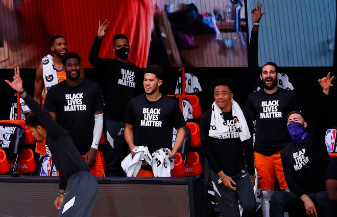 The Phoenix Suns bench reacts after their team scored a three-point basket during the fourth quarter against the Indiana Pacers during an NBA basketball game Thursday, Aug. 6, 2020, in Lake Buena Vista, Fla. (Kevin C. Cox/Pool Photo via AP).