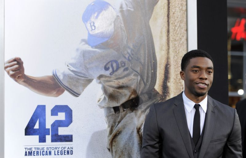"FILE - In this Tuesday, April 9, 2013 file photo, Chadwick Boseman, who plays baseball legend Jackie Robinson in ""42,"" poses at the Los Angeles premiere of the film at the TCL Chinese Theater in Los Angeles. Actor Chadwick Boseman, who played Black icons Jackie Robinson and James Brown before finding fame as the regal Black Panther in the Marvel cinematic universe, has died of cancer. His representative says Boseman died Friday, Aug. 28, 2020 in Los Angeles after a four-year battle with colon cancer. He was 43. (Photo by Chris Pizzello/Invision/AP, File)"