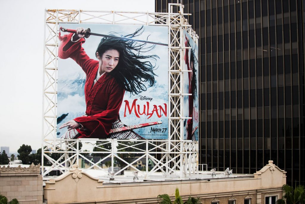"""HOLLYWOOD, CALIFORNIA - MARCH 13: An outdoor ad for Disney's """"Mulan"""" is seen on March 13, 2020 in Hollywood, California. The spread of COVID-19 has negatively affected a wide range of industries all across the global economy. (Photo by Rich Fury/Getty Images)"""