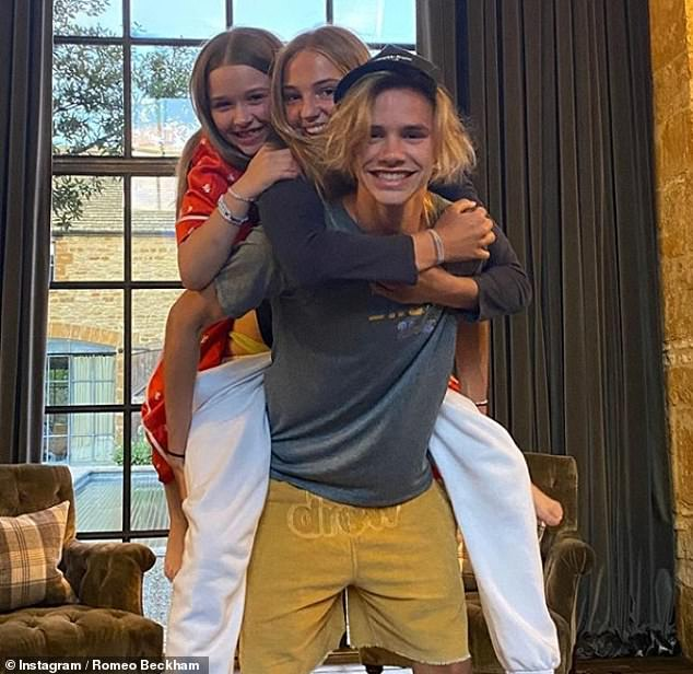 Sweet: Romeo Beckham enjoyed lockdown with his girlfriend Mia Regan, 17, and his sister Harper. They did a piggyback on Saturday with a cute Instagram snap.