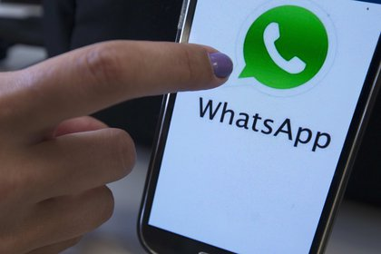 Photograph of a mobile phone with the logo of the WhatsApp technology application.  EFE / Marcelo Sayão / Archive