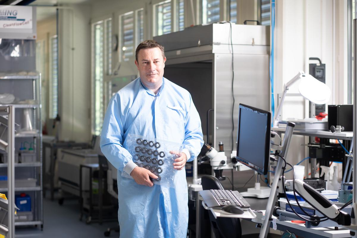 Large lenses for barcode readers, smaller for mobile phones: CEO Manuel Aschwanden at company headquarters in Dietikon with a load of Optotune lenses.